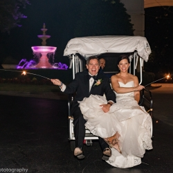 Jamie Lucido Photography captures a bride and groom leaving their wedding reception at The Ballantyne Hotel all smiles