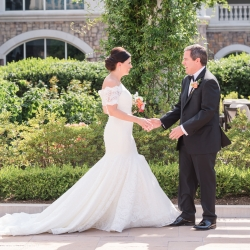 Jamie Lucido Photography captures a sweet first look between a groom and his bride on the grounds of The Ballantyne Hotel