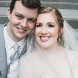 Bride and groom smile for Jenny Tenney Photography showing off amazing hair and make up by Jenny Marie Beauty during their Uptown Charlotte Wedding