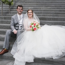 Bride and groom are all smiles during their Uptown Charlotte Wedding captured by Jenny Tenney Photography