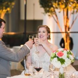 Jenny Tenney Photography captures a toast between a bride and groom during their Uptown Charlotte wedding at The Urban Garden