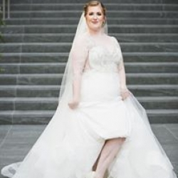 Bride shows off her sparkly shoes to Jenny Tenney Photography on her wedding day in Uptown Charlotte