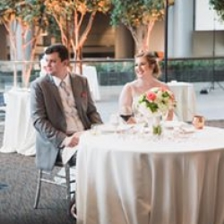Jenny Tenney Photography captures a bride and groom at their sweetheart table during a fall wedding at The Ritz Urban Garden