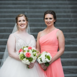 Jenny Tenney Photography captures a bride and her bridesmaid during her fall wedding at The Ritz Urban Garden