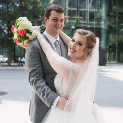Bride and groom share a moment among the city streets of Charlotte during their fall wedding at The Urban Garden