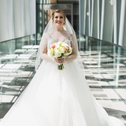 Bride poses among the amazing architecture of the Ritz Urban Garden during her Uptown Charlotte Wedding