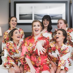 Bride shows of her ring as she gets ready with her bridesmaids wearing matching floral robes and getting pampered by Jenny Marie Beauty