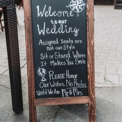 John Branch IV Photography captures a custom sign made by the bride for her fall wedding ceremony at Sugar Creek Brewery