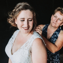 Bride and her mother share a sweet moment as they prepare for her fall wedding at Sugar Creek Brewery