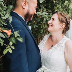 Bride is all smiles as she poses with her groom during her fall wedding coordinated by Magnificent Moments Weddings