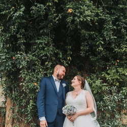 John Branch IV Photography captures a sweet moment between a bride and groom during their fall wedding at Sugar Creek Brewery