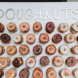 Amazing donut wall shows off sweet treats from Pepperbox Donuts during a fall wedding at Sugar Creek Brewery