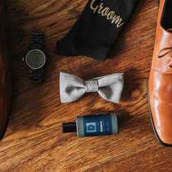 Details of groom shoes and sweet gray bow tie are the perfect accessories for a fall wedding at Sugar Creek Brewery