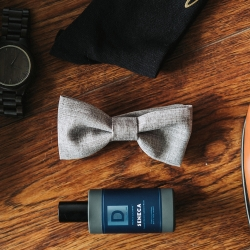 John Branch IV Photography captures the details of grooms items during a fall wedding at Sugar Creek Brewery