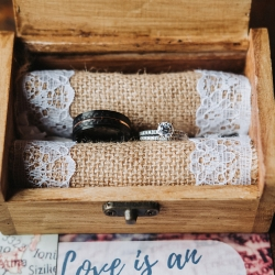 John Branch IV Photography captures the details of a custom ring box during a fall wedding ceremony at Sugar Creek Brewery
