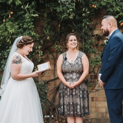Bride and groom exchange vows during their fall wedding captured by John Branch IV Photography