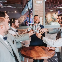 Groom shares a toast with this groomsmen as they wait to walk down the aisle