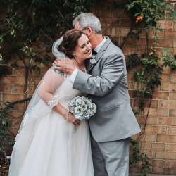 Bride and her father share a sweet moment during her wedding coordinated by Magnificent Moments Weddings