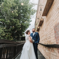 Bride and groom share a sweet moment before walking down the aisle at Sugar Creek Brewery