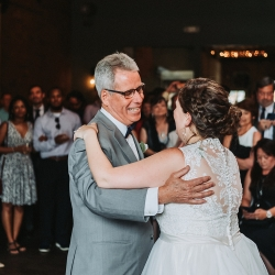 Bride dances with her father during a sweet dance coordinated by Magnificent Moments Weddings
