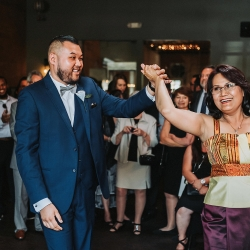 Groom dances with his mother to music by Benjamin T Warner during his wedding reception coordinated by Magnificent Moments Weddings