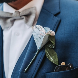 Custom map roses were the perfect touch for a travel themed wedding at Sugar Creek Brewery