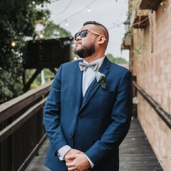 Groom poses for John Branch IV Photography during his fall wedding in Charlotte North Carolina