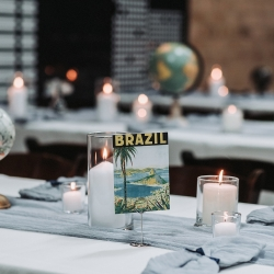 Travel themed tables show off the couples trips during a fall wedding at Sugar Creek Brewery