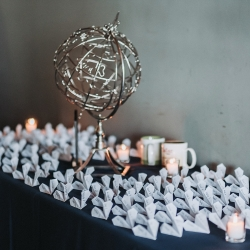 Fun paper airplanes were the perfect escort cards for a fall wedding at Sugar Creek Brewery