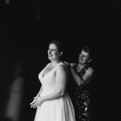 Bride and her mother share a sweet moment as they put on their finishing touches captured by John Branch IV Photography