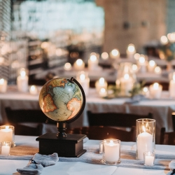 Globes and candles were the perfect accents to a travel themed wedding at Sugar Creek Brewery