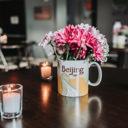 Travel themed mugs were the perfect touches to florals during a fall wedding captured by John Branch IV Photography