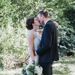 Bride and groom share a kiss after their first look captured by John Branch IV Photography