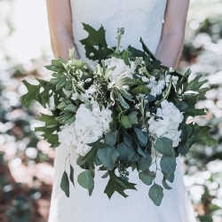 John Branch IV Photography captures a bridal bouquet full of greenery and white floral accents
