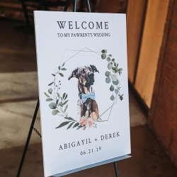 Custom welcome sign for a summer wedding at Triple C Barrel Room features the couples dog Bear