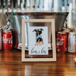 Custom printed signage for the bar shows off the couples fur baby for a summer wedding in Charlotte North Caorlina