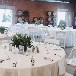 Crisp white linens and greener accents were the perfect touch for a summer wedding at Triple C Barrel Room