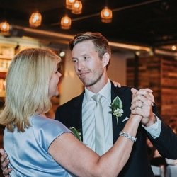 Groom shares a first dance with his mother during his wedding reception at Triple C Barrel Room coordinated by Magnificent Moments Weddings