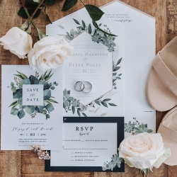 Stunning invitation suite features greenery accents for a natural wonder wedding at Triple C Barrel Room