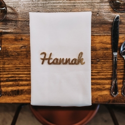 Custom name places were the perfect accents to farmhouse tables rented by Best Impressions Catering for a summer wedding at Triple C Barrel Room