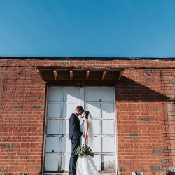 John Branch IV Photography captures bride and groom in the city of Charlotte during their summer wedding coordinated by Magnificent Moments Weddings