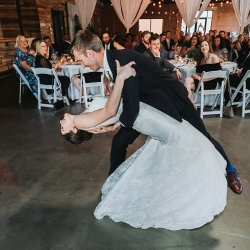 Bride and groom share a first dance choreographed by First Dance Charlotte during their summer wedding at Triple C Barrel Room