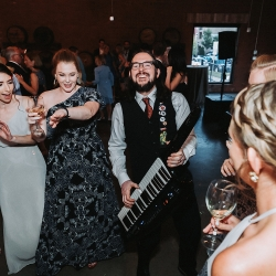 Hot Sauce Band kept the dance floor packed for a summer wedding at Triple C Barrel Room coordinated by Magnificent Moments Weddings