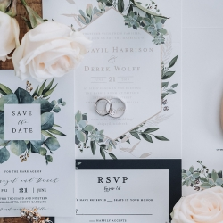 John Branch IV Photography captures the details of a invitation suite for a summer wedding coordinated by Magnificent Moments Weddings