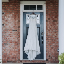 John Branch IV Photography captures the details of a stunning bridal gown before a summer wedding in Charlotte, North Carolina
