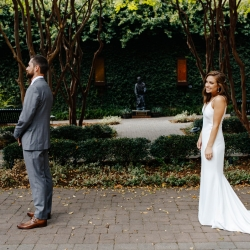 Bride approaches her groom in a planned first look coordinated by Magnificent Moments Weddings