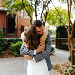 Bride and groom embrace during a sweet first look during their fall wedding at The Mint Uptown
