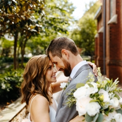 Bride and groom embrace during their Uptown Charlotte wedding captured by Jordyn Schirripa Photography