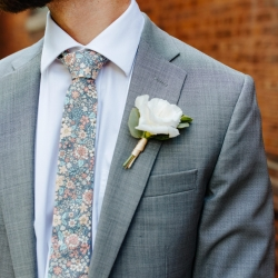 Jordyn Schirripa Photography captures the simple boutineer for a groom created by Lily Greenthumbs