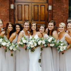 Bride and her bridesmaids hold stunning bouquets created by Lily Greenthumbs for their uptown Charlotte wedding